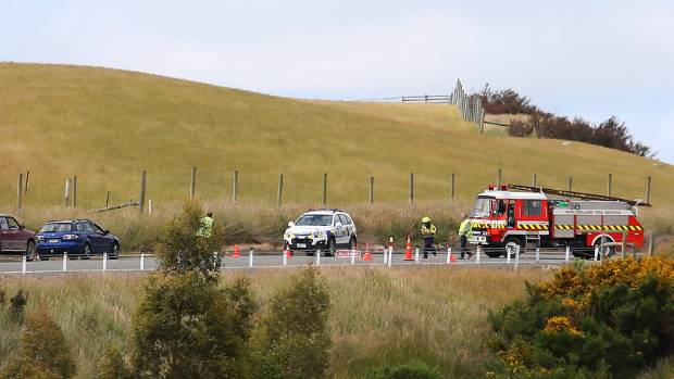 Emergency services at the scene of a collision between a car and pedestrian 8km south of Lumsden.