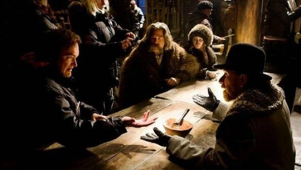 Quentin Tarantino on the set of The Hateful Eight, with cast members including Kurt Russell, centre, and Tim Roth, right.