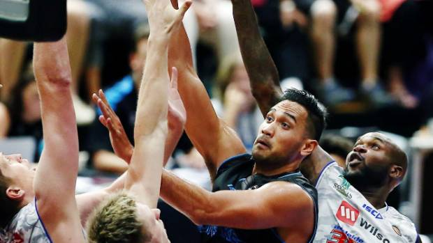 Breakers forward Tai Wesley shoots over the Adelaide 36ers defence during their ANBL clash at the North Shore Events Centre,