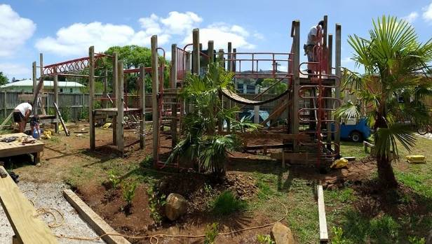 Builders put the finishing touches on an adventure playground at Stephen Daly's home in Whangarei last year.