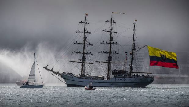 Tug boats welcome Ecuadorian tall ship the Guayas into a fog-bound Wellington harbour early on Sunday evening after seven months at sea.