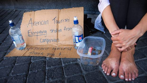 American tourists who claim everything was stolen from their camper van have taken to begging on the street.