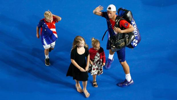 Australia's Lleyton Hewitt leaves the court and waves goodbye to his career with his three children after playing his ...