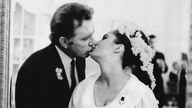 Richard Burton and Elizabeth Taylor pictured at their first wedding. They married twice but divorced each time.