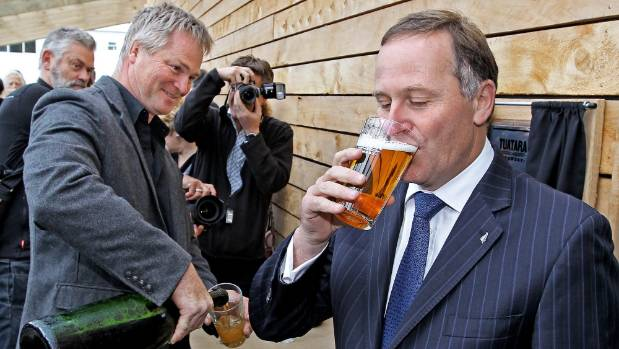 Prime Minister John Key drinks a beer at the opening of the Tuatara Brewery in Paraparaumu. Key says he will remain as ...
