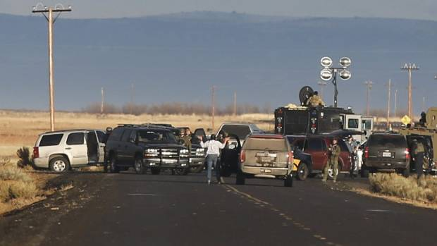 A local resident is stopped and made to exit her vehicle at a roadblock near the headquarters of the Malheur National ...
