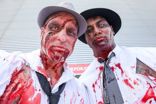 Cory Jane and Julian Savea pose in their zombie costumes.