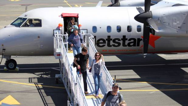 Passengers disembark the first flight Jetstar landing from Wellington into Nelson Airport.