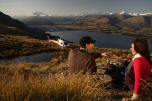 Take a helicopter ride to a glacier and mountain peak for an unforgettable picnic in Queenstown.