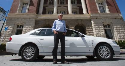 "Christchurch-based chauffeur Robin Adams acts as both taxi driver and guide for overseas visitors. ""I mother them all the way around."""
