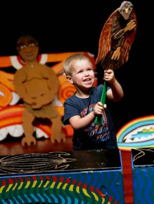 Leo Whittington, 4, of Palmerston North, participates in the Toro Pikopiko Puppets performance of  Mighty Maui at the Globe Theatre by holding up a kahu (hawk) during the storytelling during Waitangi Day.