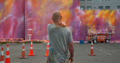 Artist Ash Keating returned to Manchester St on Saturday to revamp his mural after it was tagged recently.