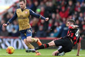 Bournemouth's Andrew Surman defends against Arsenal's Aaron Ramsey.
