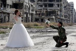 Newly-wed Syrian couple Nada Merhi,18, and Hassan Youssef, 27, pose for a wedding picture in Homs.