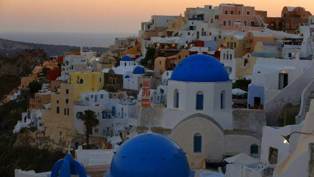 The sun sets on the picture-perfect Greek island of Santorini.