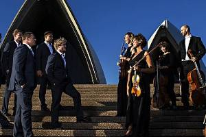 Players from the NSW Waratahs and members of the Sydney Symphony Orchestra on the steps of the Sydney Opera House.