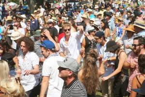 Festival-goers dance it up in the sun during an afternoon set from Tahuna Breaks.