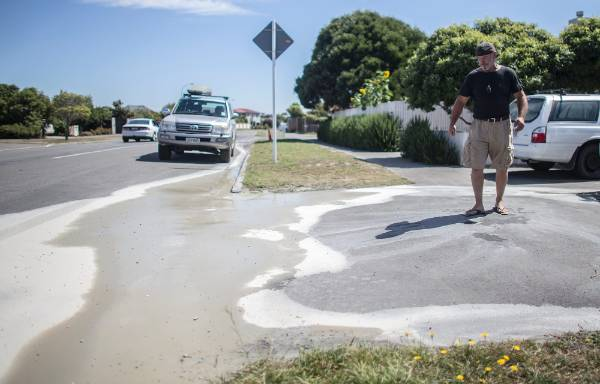 Danny Morris checks out the liquefaction outside his Broadhaven Ave house in Parklands.