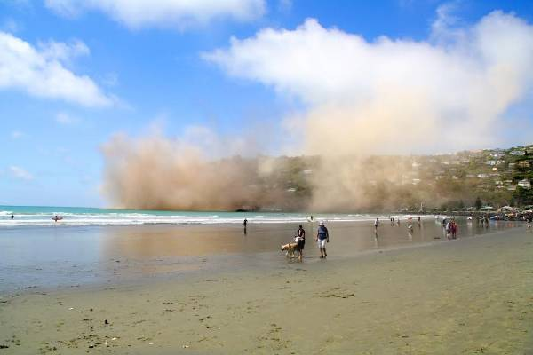 Huge clouds of dust rise in Sumner, almost blocking the view, following Sunday's earthquake. ,