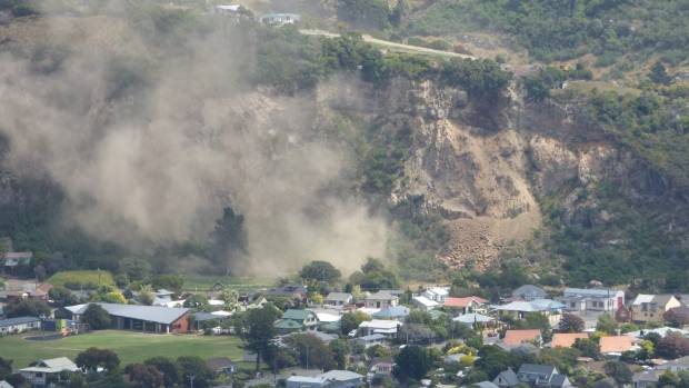 A collapse on Richmond Hill cliff sends dust over Sumner just after the shaking stopped.