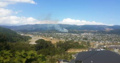 Smoke on the hills above Maidstone Park