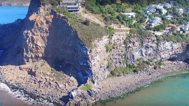 The quake left just a few metres of land remaining between one house and the edge of the cliff.