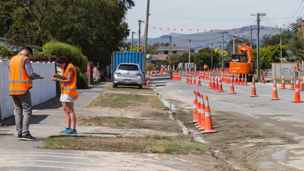 Geotechnical engineers from Tonkin + Taylor assess new earthquake damage down Bower Ave in Parklands, Christchurch.