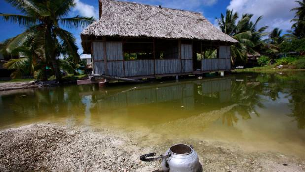 An abandoned house affected by seawater during high tides in Kiribati in May 2013.
