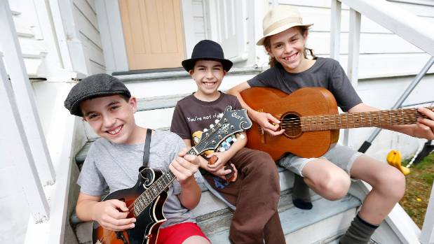 he multi instrumentalist Frangos-Rhodes brothers Sam, 12, Nate, 9, and Laurence 14 who star in a family band, Rhode Workz.
