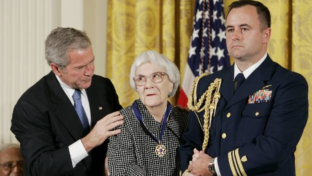 US President George W Bush (left) awards the Presidential Medal of Freedom to American novelist Harper Lee (centre) in ...