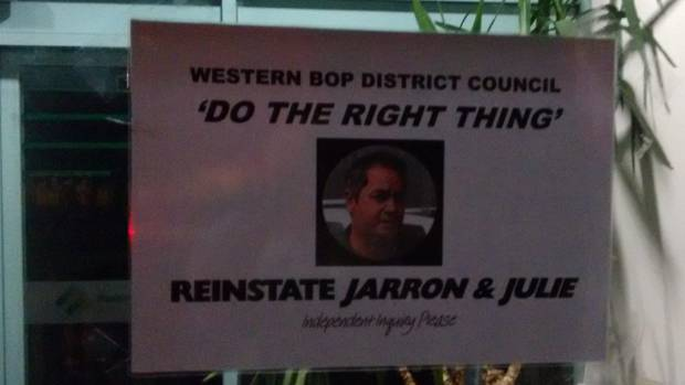 Someone placed a sign in the window of Western Bay of Plenty District Council demanding Jarron McInnes be reinstated