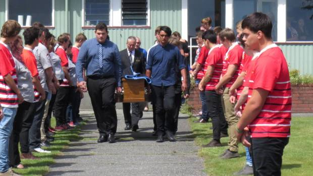 Scouts and rugby players formed a guard of honour as Mitchell Heward's coffin was carried from his funeral service on ...