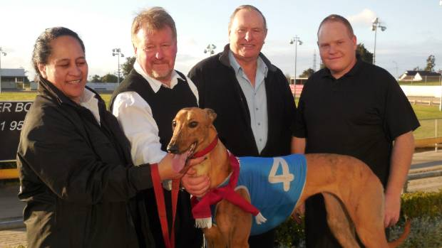 Trainer Steve Clark, second from left, with connections of Jay Low, the greyhound put down after racing at Auckland on ...
