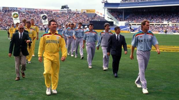 Australian captain Alan Border and New Zealand Captain Martin Crowe lead their teams onto the field for the first ...