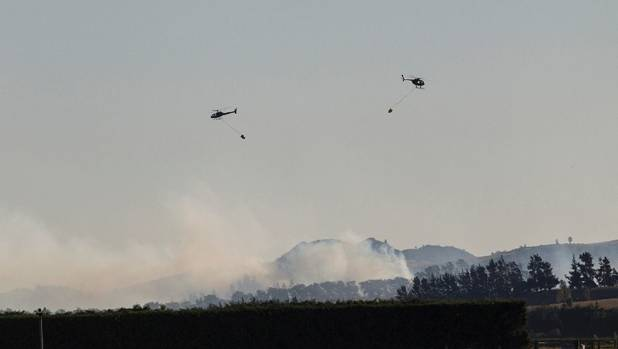 Six helicopters fought the fire, thought to have started from farm burn-off re-sparking.
