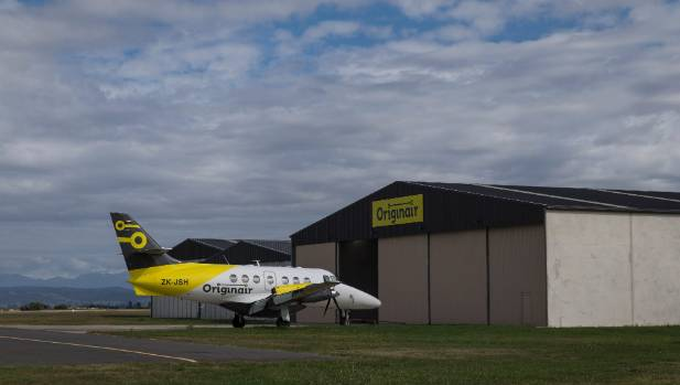 A Jetstream 32 parked outside the Originair hangar at Nelson Airport.