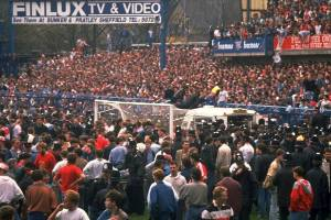 Supporters are crushed against the barrier as disaster strikes at the Leppings Lane end at Hillsborough.