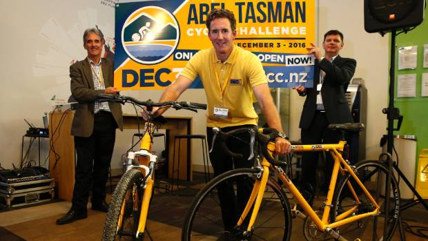 John McIntyre organiser of the Abel Tasman Cycle Challenge with Tasman mayor Richard Kempthorne, left and Nelson Airport ...