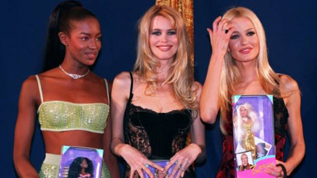 Supermodels Naomi Campbell (L), Claudia Schiffer (C), and Karen Mulder (R) hold their custom-made dolls.