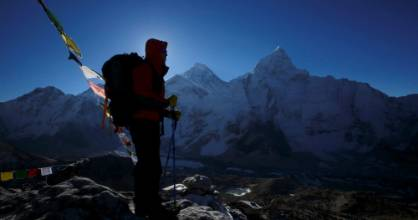 A trekker stands in front of Mount Everest, which is 8,850 meters high, at Kala Patthar in Solukhumbu District May 7, 2014.