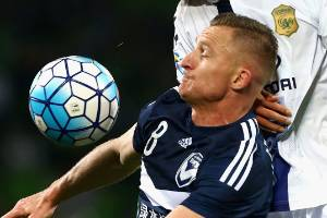 Besart Berisha of the Melbourne Victory and Jang Yunho of Jeonbuk contest the ball during the AFC Champions League match.