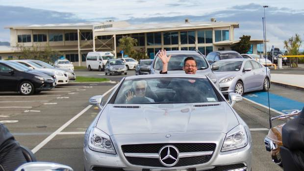 Gareth Farr leaving Nelson airport in style, met by a silver Mercedes convertible and three Harley Davidson motorbikes ...