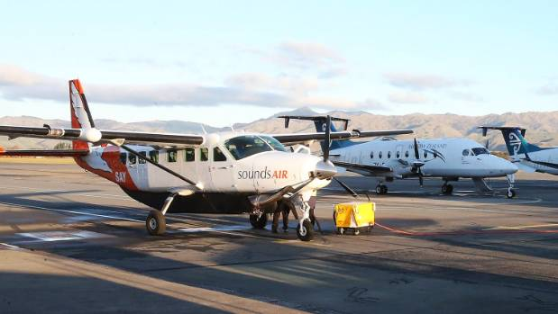 A Sounds Air Cessna Caravan on the tarmac at Marlborough Airport, beside a Beechcraft 1900D that Air New Zealand ...