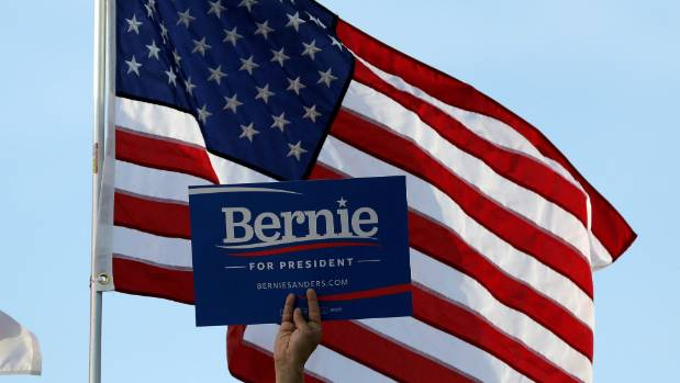 A supporter of Democratic U.S. presidential candidate Bernie Sanders holds up a placard during a campaign rally in ...