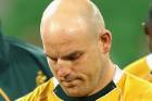 Wallabies captain Stephen Moore and team-mates look dejected after losing the second test against England and June.