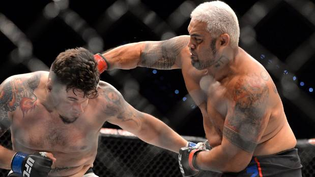 Nunes stuns Tate to claim title in UFC 200 main event