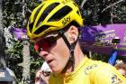 Chris Froome takes off running up the final climb on Mont Ventoux after crashing with a Tour motorbike.