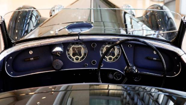 A 1939 Alfa Romeo 8C 2900B Lungo Touring Spider is displayed at Sotheby's in New York City.