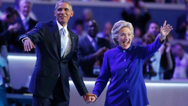 Democratic presidential nominee Hillary Clinton joins President Barack Obama after his speech at the Democratic National ...