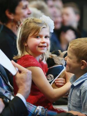 Amelia  waits to be called to the stage for her bravery award. Her brother Finn was pretty excited for her.